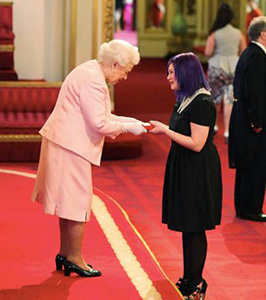 The Queen presents Tabby Besley, of Wellington, with a Queen's Young Leader Award at Buckingham Palace on Monday night.